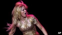 """Colombian pop star Shakira performs during her concert as part of """"The Sun Comes Out World Tour"""", at the Lluis Companys Olympic stadium in Barcelona May 29, 2011."""
