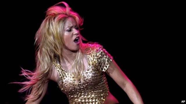 "Colombian pop star Shakira performs during her concert as part of ""The Sun Comes Out World Tour"", at the Lluis Companys Olympic stadium in Barcelona May 29, 2011."