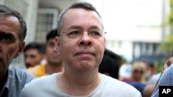 FILE - Andrew Craig Brunson, an evangelical pastor from Black Mountain, North Carolina, arrives at his house in Izmir, Turkey, July 25, 2018, where he is being held under house arrest.