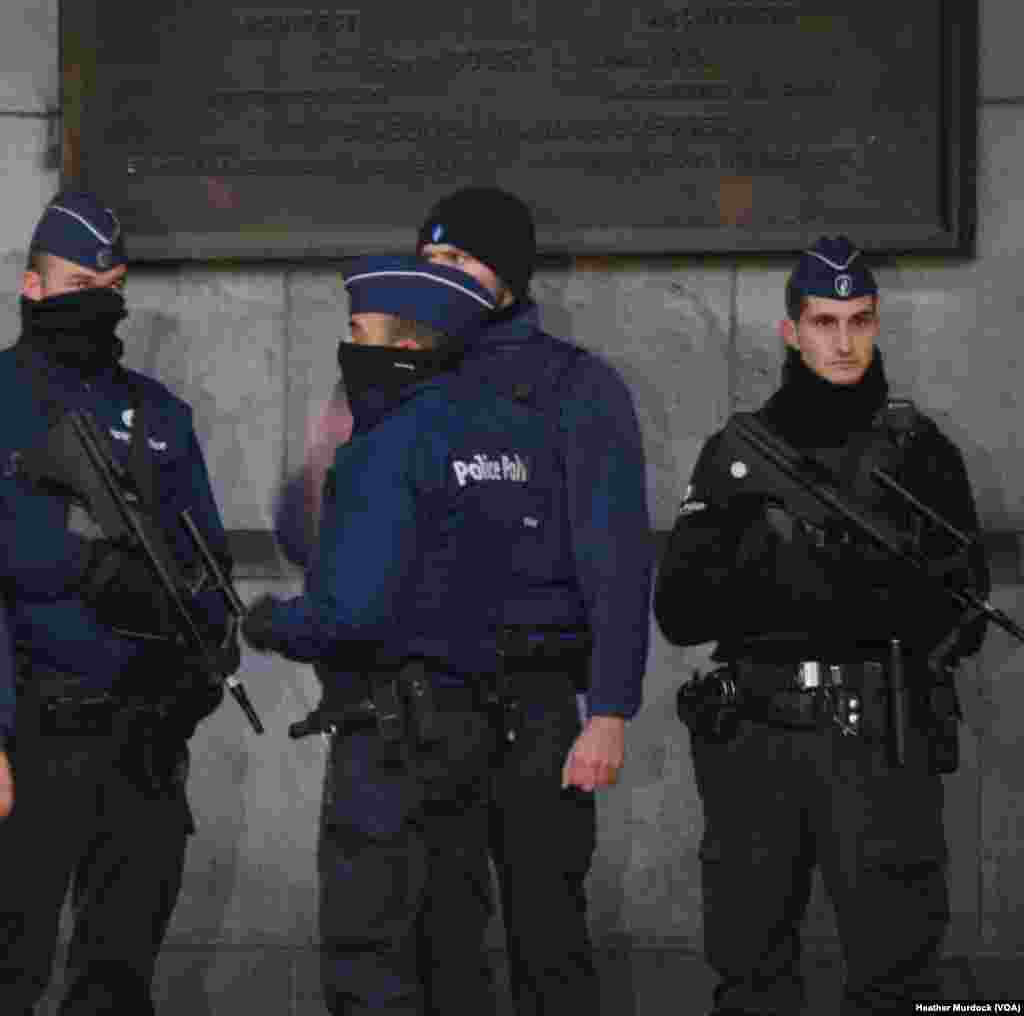 Police and soldiers guard Brussels' main train station, which is still open for passengers coming in from out of town, Nov. 24, 2015.
