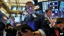 Trader Ronald Madarasz, center, works on the floor of the New York Stock Exchange, March 10, 2020.
