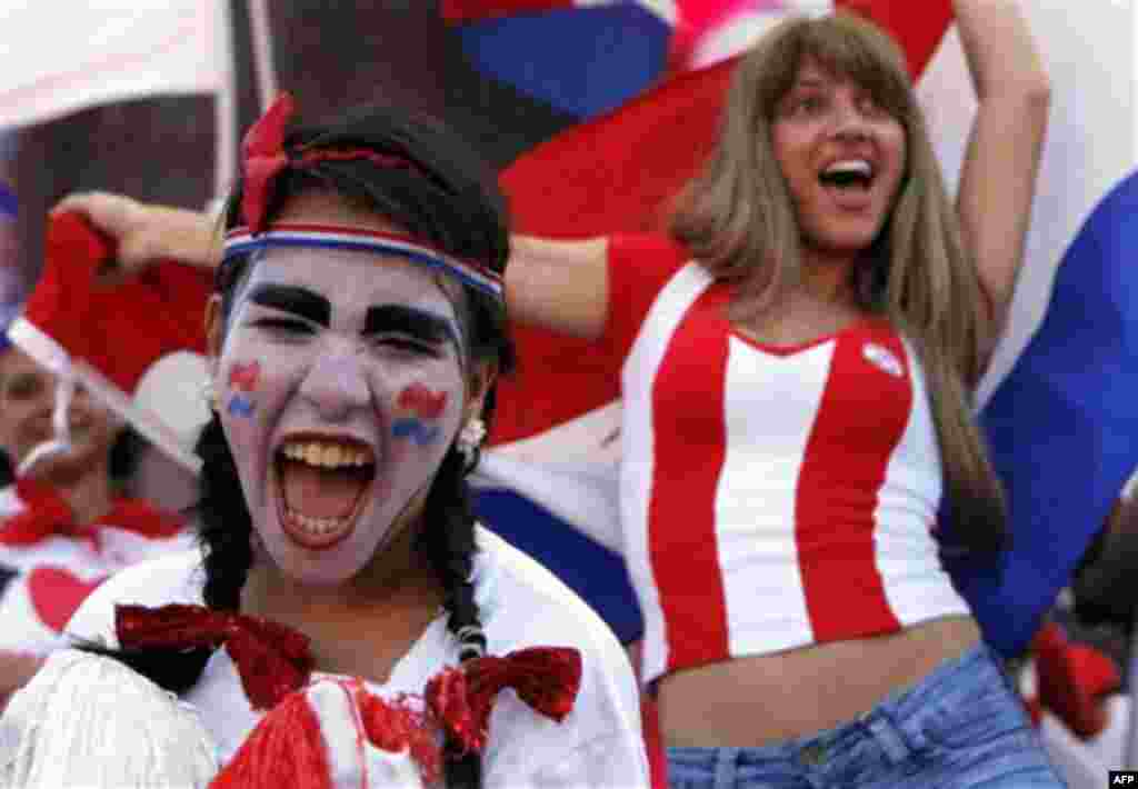 Soccer fans celebrate Paraguay making it to the next round of the South Africa 2010 WCup, after a match against New Zealand, in Asuncion, Thursday, June 24, 2010. Paraguay was held to a 0-0 draw by New Zealand in the match, but still won its World Cup gro