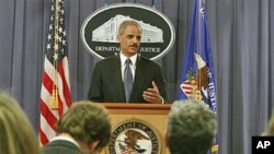 Attorney General Eric Holder gestures during a news conference at the Justice Department in Washington, where he announced plans to try avowed 9/11 mastermind Khalid Sheikh Mohammed and four alleged henchmen before a military commission, April 4, 2011