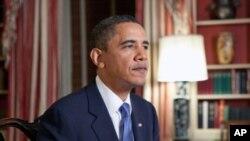 صدر اوباما30جنوری کو ہفتہ وار تقریر کرتے ہوئے