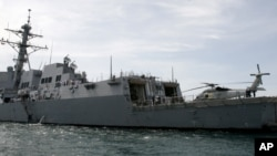 FILE - The guided missile frigate USS Mustin port upon the arrival near Cambodia's port town of Sihanoukville some 185 kilometers (115 miles) southwest of Phnom Penh, Cambodia.