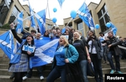 FILE - 'Yes' campaigners cheer during a rally in Glasgow, Scotland, Sept. 17, 2014.