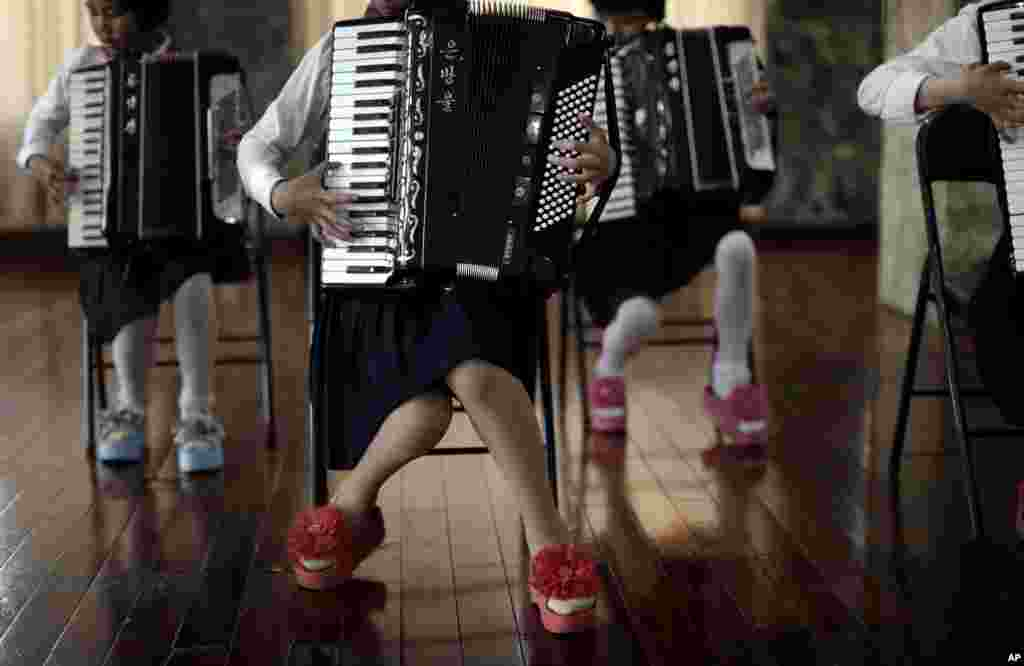 School girls perform a song during an accordion class in Pyongyang, North Korea.
