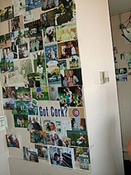Pictures of fans and their families grace the wall behind where Nancy Faust plays the organ at White Sox baseball games.
