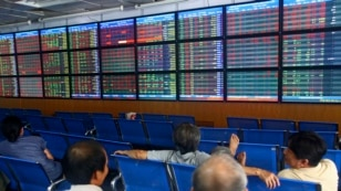 Investors and brokers in the Asia Commercial Bank (ACB) Stock Exchange in Hanoi, Vietnam.