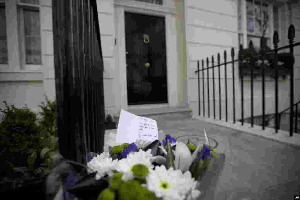 A floral tribute is seen after being laid outside the home of the late former British Prime Minister Margaret Thatcher in London.