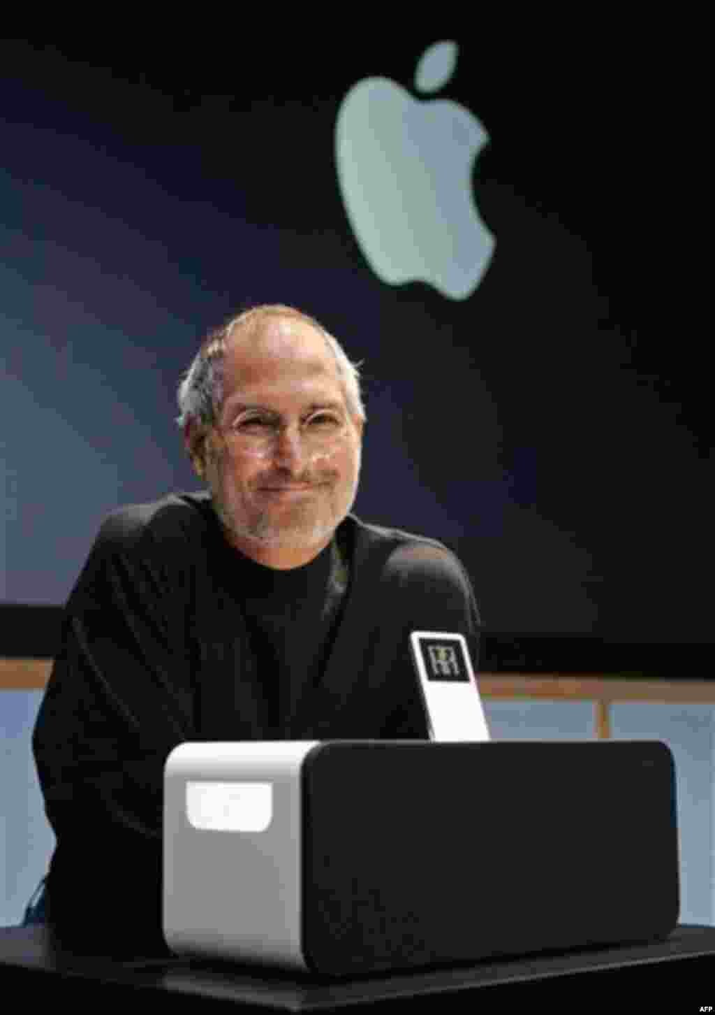 Apple Computer Inc. CEO Steve Jobs smiles next to the new Apple iPod Hi-Fi speaker system for its iPod player at an unveiling at Apple headquarters in Cupertino, Calif., Tuesday, Feb. 28, 2006. (AP Photo/Paul Sakuma)