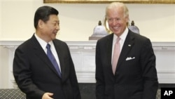 时任中国国家副主席习近平2012年2月14日访问白宫时与美国副总统拜登会晤