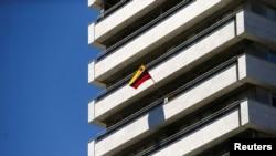 A Venezuelan flag flies on a balcony of the Venezuelan embassy in Madrid, Spain, May 15, 2018.