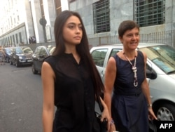 FILE - Italian beauty queen Ambra Battilana, pictured in Milan in July 2013, says she felt pressured to sign a nondisclosure agreement after having accused media mogul Harvey Weinstein of groping her in 2015.
