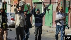Libyan rebel fighters celebrate after taking partial control of the coastal town of Zawiya, 50 km (30 miles) west of Tripoli, August 14, 2011.