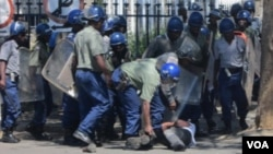 Police arrest a protester in Bulawayo following a planned demonstration in the city.