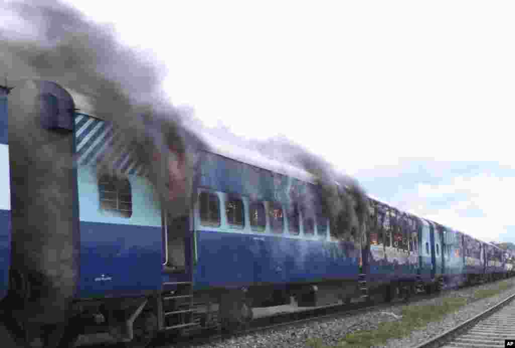 Coaches of the Rajya Rani Express train burn after a mob set it on fire after it ran over a group of Hindu pilgrims at a crowded station in Dhamara Ghat, Bihar state, India, August 19, 2013.
