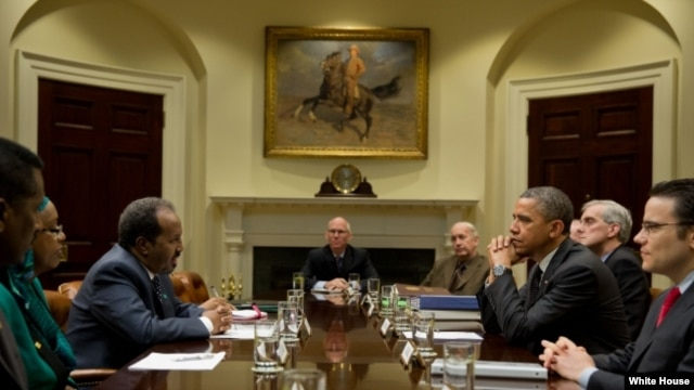 President Barack Obama drops by a meeting with President Hassan Sheikh Mohamud of Somalia and Deputy National Security Advisor Denis McDonough in the Roosevelt Room of the White House, Jan. 17, 2013.