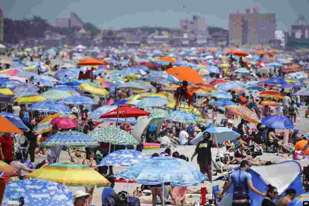 People enjoy the beach at Coney Island, July 4, 2020, in the Brooklyn borough of New York.
