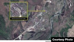 FILE - Housing construction is underway at Camp 16, North Korea, in May 2013.