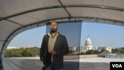Spanish broadcaster JP Zarruk reporting live from the new standup location on the rooftop of VOA's headquarters in Washington, DC.