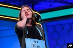Erin Howard, 14, of Huntsville, Ala., reacts as she prepares to spell her final word as she competes in the finals of the 2019 Scripps National Spelling Bee in Oxon Hill, Md., Thursday, May 30, 2019.