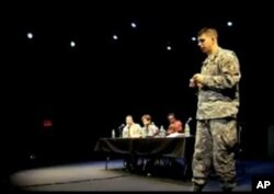 Maj. Joseph Geraci speaks at a town hall-style discussion following a 'Theater of War,' performance.