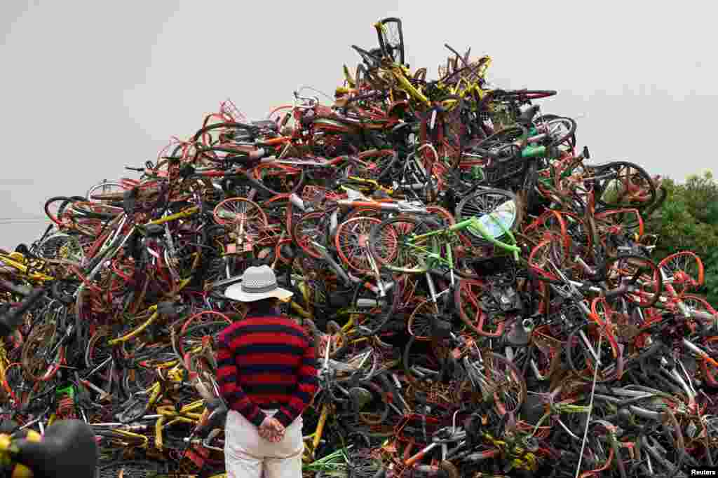 Bicycles of various bike-sharing services are seen in a garbage dump in Shanghai, China.