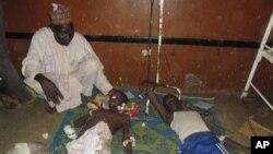 Người bị thương sau vụ đánh bom ở Potiskum, Nigeria, ngày 10/11/2014.
