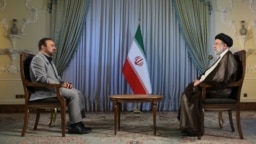 A handout picture provided by the Iranian presidency on Oct. 18, 2021 shows Iranian president Ebrahim Raisi during and interview with an Iranian TV channel. (Iranian Presidency / AFP)