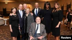 Former U.S. Presidents and former U.S. first ladies Laura Bush, George W. Bush, Bill Clinton, Hillary Clinton, Barack Obama, Michelle Obama, and first lady Melania Trump pose with former U.S. President George H.W. Bush at the funeral of Barbara Bush in Houston.