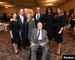 Former U.S. Presidents and former U.S. first ladies Laura Bush, George W. Bush, Bill Clinton, Hillary Clinton, Barack Obama, Michelle Obama, and first lady Melania Trump pose with former U.S. President George H.W. Bush at the funeral of Barbara Bush in Houston