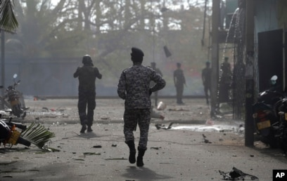 Sri Lankan security forces approach the site after a vehicle parked near St. Anthony's shrine exploded in Colombo, Sri Lanka, April 22, 2019.