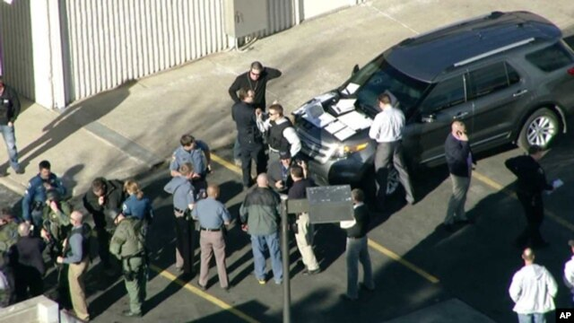 In this still image taken from video provided by Fox 31 Denver, police respond to reports of a shooting at Arapahoe High School in Centennial, Colorado, Dec. 13, 2013.