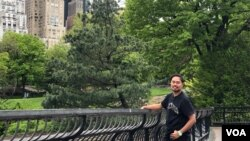 Jakkrit Yompayorm flashes a smile in New York City's Central Park. (Photo by Janine Phakdeetham)