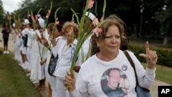 Laura Pollan, leader the Cuban dissident group Ladies in White, protests after the group's weekly march in Havana, 7 Nov. 2010.