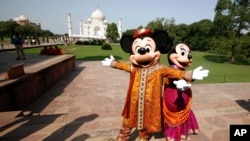 FILE - Walt Disney cartoon characters Mickey Mouse (L) and Minnie Mouse pose at the Taj Mahal in Agra, India, Oct. 30, 2008. Disney staged its first Broadway show in India in Mumbai in 2012.
