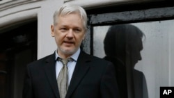 FILE - WikiLeaks founder Julian Assange speaks from the balcony of the Ecuadorean embassy in London, Feb. 5, 2016.