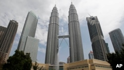 The Petronas Twin Towers in Kuala Lumpur are named for the state-owned oil company that provide much of the Malaysian government's revenue.