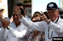 Peru's President Pedro Pablo Kuczynski, right, visits Cantagallo, an indigenous Shipibo-Konibo community, in Lima, Peru, Dec. 16, 2016.