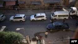 Vehicles of a UN and SARC aid convoy, with food, nutrition, health and other emergency items, enter the rebel-held town of Douma, east of the Syrian capital Damascus, June 10, 2016.