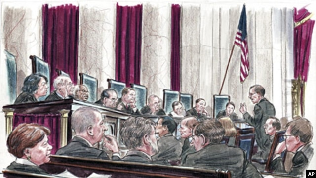 In this courtroom illustration, U.S. Solicitor General Donald Verrilli (R) speaks at the lectern to members of the U.S. Supreme Court in Washington, March 27, 2012