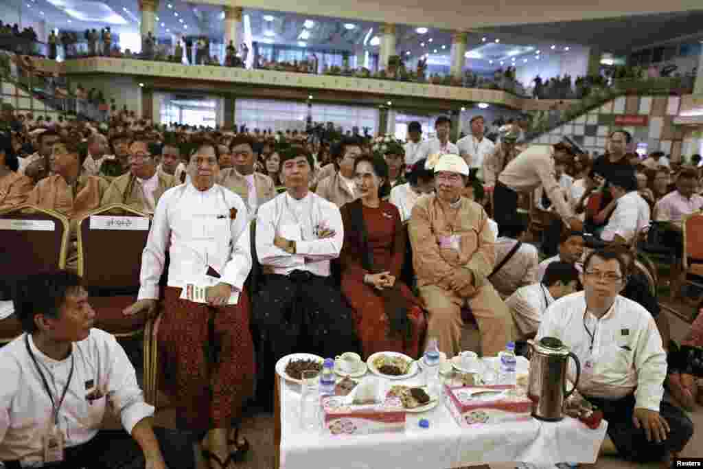 "Burmese pro-democracy leader Aung San Suu Kyi and 88 generation student leader Min Ko Naning attend an event on the 25th anniversary of the democratic uprising known also as ""8888"", Rangoon, August 8, 2013."