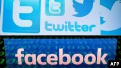美国社交媒体公司脸书和推特的标志。