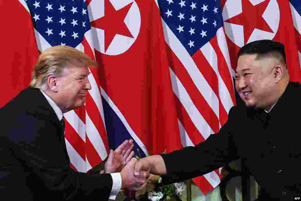 U.S. President Donald Trump (L) shakes hands with North Korean leader Kim Jong Un following a meeting at the Sofitel Legend Metropole hotel in Hanoi, Vietnam.