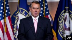 House Speaker John Boehner speaks about the trade bill during a news conference on Capitol Hill in Washington, June 11, 2015.