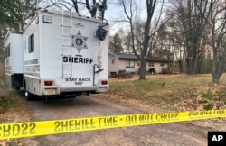 FILE - In this Oct. 23, 2018, file photo, a Barron County, Wis., sheriff's vehicle is parked outside the home where James Closs and Denise Closs were found fatally shot on Oct. 15.