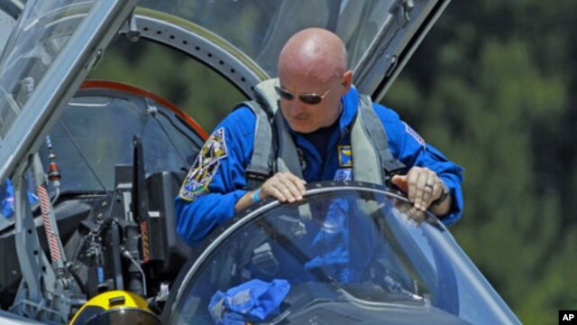 Mission Commander Mark Kelly climbs from his T-38 jet trainer as he arrives with the crew of space shuttle Endeavour's mission STS-134 at the Kennedy Space Center in Cape Canaveral, Florida, April 26, 2011