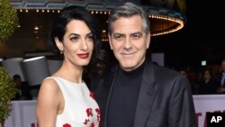 "FILE - Amal Clooney, left, and George Clooney arrive at the world premiere of ""Hail, Caesar!"" in Los Angeles."