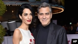 "FILE - Amal and George Clooney are pictured in Los Angeles, Feb. 1, 2016. They are donating funds to and will participate in the ""March for Our Lives"" rally in Washington on March 24, 2018."
